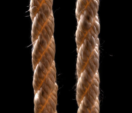 thick rope hanging on a background of black walls