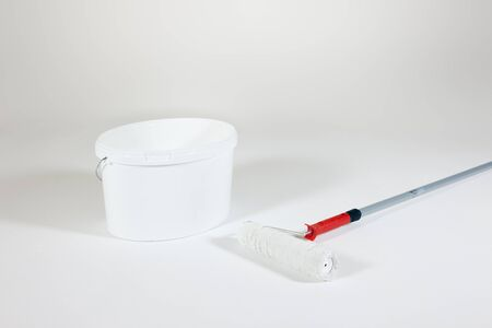 white painting with paint roller and bucket