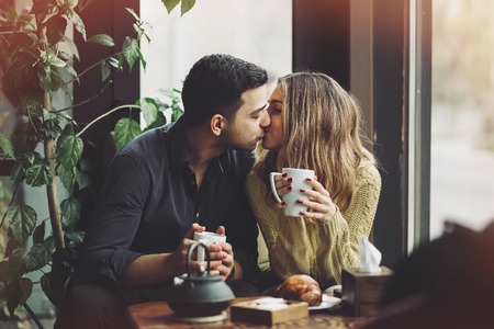 Photo for Couple in love drinking coffee and have fun in coffee shop. Love concepts. Vintage effect style picture - Royalty Free Image