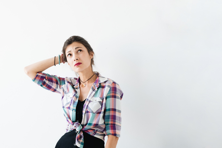 Worried  female studio shot