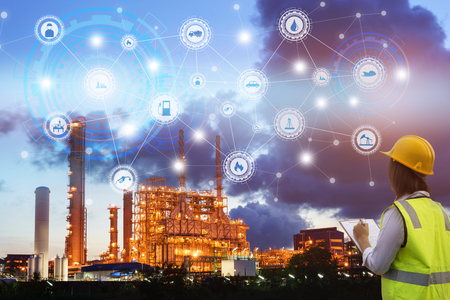 Photo pour Industry 4.0 concept engineering use clipboard with checking and industrial icons on oil refinery industry sunset background. - image libre de droit