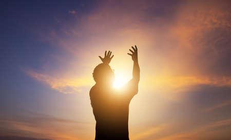 Photo pour Human hands open palm up worship on sunset - image libre de droit