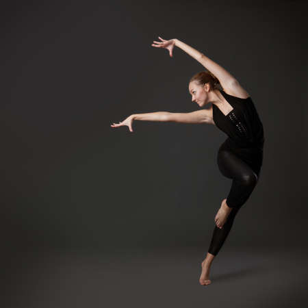 Photo for attractive young woman dancing - Royalty Free Image