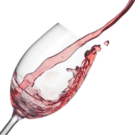 Splash of rose wine in wineglass on white
