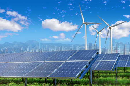 Photo for Solar panels and wind turbines with city - Royalty Free Image