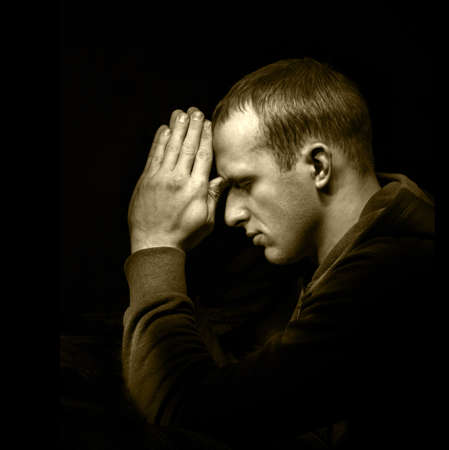 Photo pour Dramatic orthodox evangelical baptist pious lonely stress mourn young white guy kneeling for ask implore wish upwards Jesus Christ. Modern think concept copyspace with space for text on dark backdrop - image libre de droit