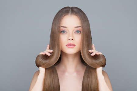 Photo pour Healthy Hair Woman on Light Blue Background - image libre de droit