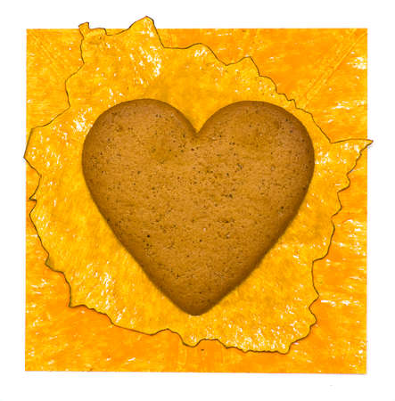 Yellow paper background with cookies heart
