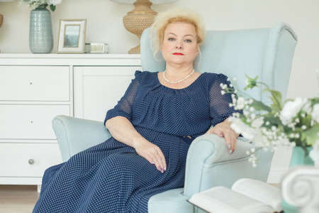 Foto per Portrait of beautiful older woman resting at home - Immagine Royalty Free