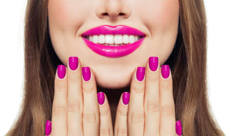 Photo pour Nails and lips. Woman touching her cheeks her hands with manicure nails. Pink color lipstick and nail polish - image libre de droit