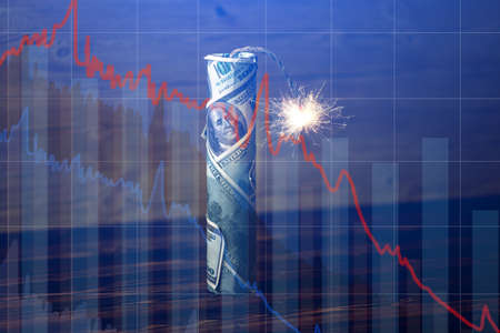 Foto de Bomb money like dynamite, hundred-dollar bill with a burning wick with drop charts on blue background. Waiting for the explosion of investment markets. The concept of the financial crisis - Imagen libre de derechos