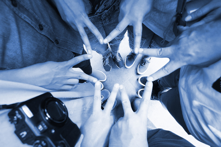 Group of People showing hands finger connecting to star shape - Teamwork Concept