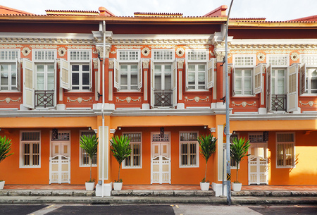 Singapore - JUNE  17 2015: Singapore local vintage buiding with orange color theme in Chinatown Singapore