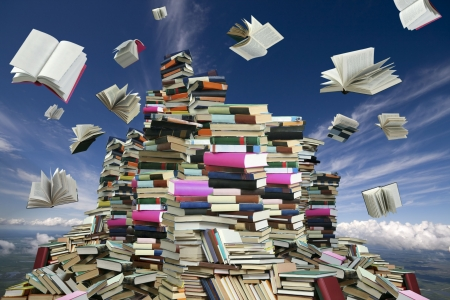 Photo pour This is books mountain. Many books on background of white clouds and blue sky. - image libre de droit