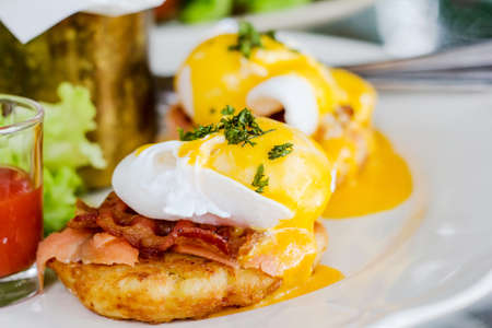 Eggs Benedict- toasted English muffins, ham, poached eggs, and delicious buttery hollandaise sauce