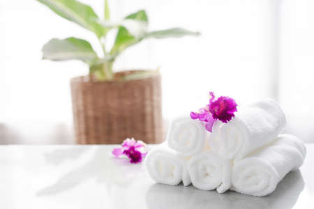 Photo pour Towels on table with copy space blurred bathroom background. For product display montage. - image libre de droit