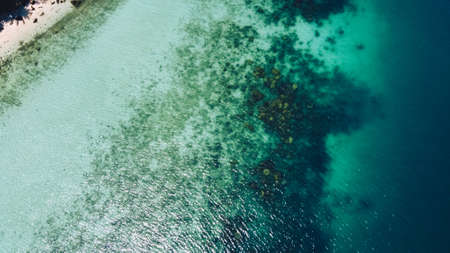 Photo pour Clear water on the island,Bright blue sea and beach Bird's Eye View - image libre de droit
