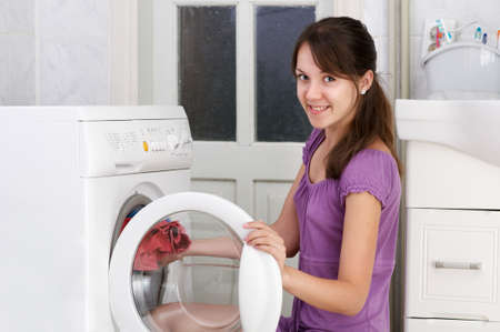The beautiful girl is washing clothes