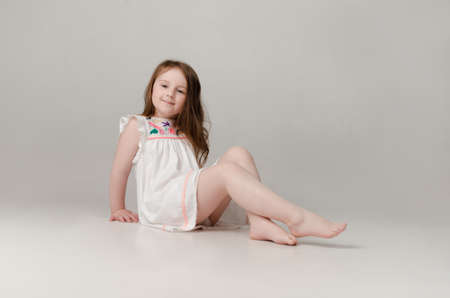 child in the Studio posing in fashionable clothesの写真素材