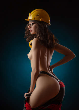 Photo for photos of naked girls in construction helmet and work clothes - Royalty Free Image