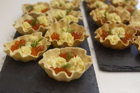 Home-made bread tartlets for fish caviar snacks and egg sauce