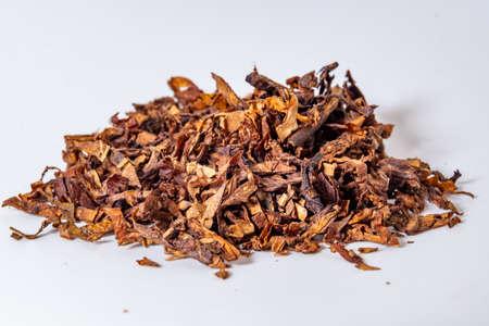 Photo pour A handful of tobacco on a white background close-up - image libre de droit
