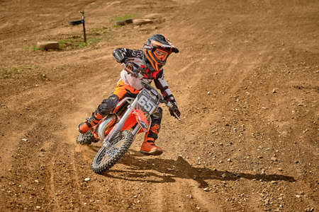 Photo pour A child at a motocross training session in Moscow at the Technical Sports Stadium 2019 - image libre de droit