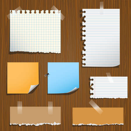 Notes paper on wooden background.