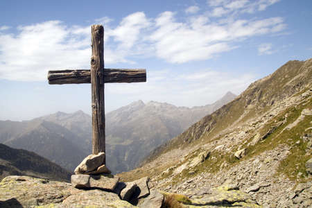 Wooden cross standing in italian Alps