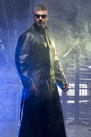 Matrix Style Role Play Character Adult Man in Trench Coat in old factory