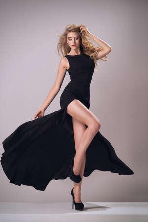 Foto de Cute woman in gorgeous dress - Imagen libre de derechos