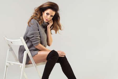 Beauty brunette woman on chair