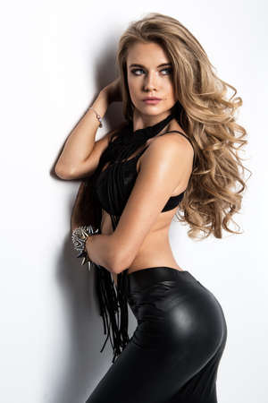 An attractive lady in black latex trousers. Fashion look