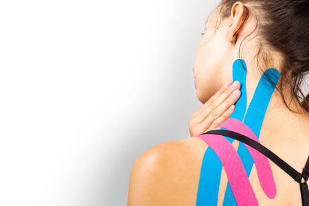 Photo for Kinesiotaping, kinesiology. Female athlete with kinesiotape, muscle tape on shoulder - Royalty Free Image