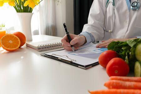 Photo pour Vegetable diet nutrition and medication concept. Nutritionist offers healthy vegetables diet. In a natural light - image libre de droit