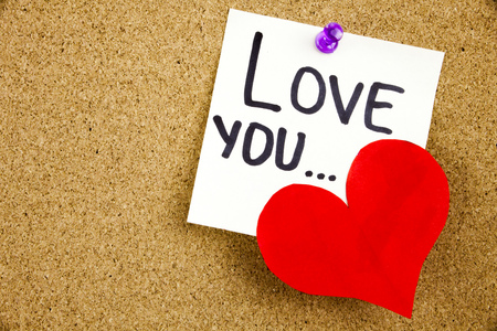 Phrase LOVE YOU ... in black ext on a WHITE sticky note pinned to a cork notice board