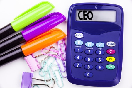 Writing word CEO text in the office with surroundings such as marker, pen writing on calculator. Business concept for Operating Leader Business Executive President white background with space