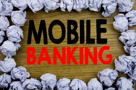 Handwriting Announcement text showing Mobile Banking. Business concept for Internet Banking e-bank written on wooden wood background with on old background with folded paper balls