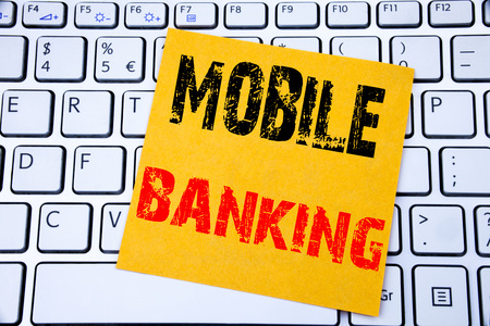 Mobile Banking. Business concept for Internet Banking e-bank written on sticky note paper on white keyboard background.