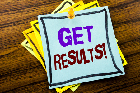 Writing text showing Get Results. Business concept for Achieve Result written on sticky note paper on wooden background.