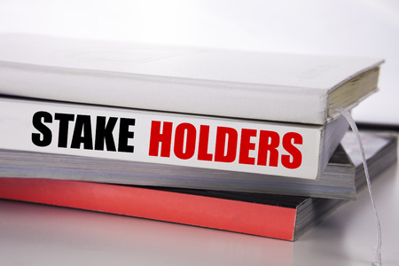 Writing text showing Stake Holders. Business concept for Stakeholder Engagement written on the book the white background.
