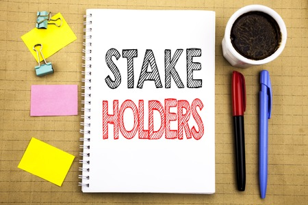Word, writing Stake Holders. Business concept for Stakeholder Engagement Written on notepad paper background with space office view with pencil marker coffee