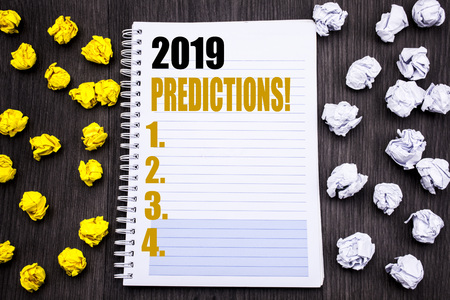 Conceptual hand writing text caption showing 2019 Predictions. Business concept for Forecast Predictive Written notepad note notebook book wooden background with sticky folded yellow and white