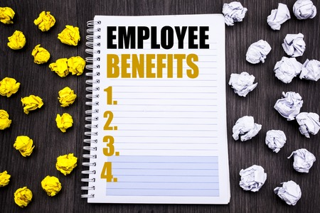 Conceptual hand writing text caption showing Employee Benefits. Business concept for Compensation Career Written notepad note notebook book wooden background with sticky folded yellow and white