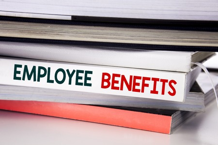 Word, writing Employee Benefits. Business concept for Compensation Career written on the book the white background.