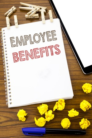 Writing text showing Employee Benefits. Business concept for Compensation Career written on note paper folded Meaning Thinking paper on the wooden background with marker and coffee
