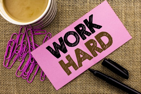 Photo pour Handwriting text writing Work Hard. Concept meaning Struggle Success Effort Ambition Motivation Achievement Action written Pink Sticky Note Paper the jute background Coffee Cup Pen Pins. - image libre de droit