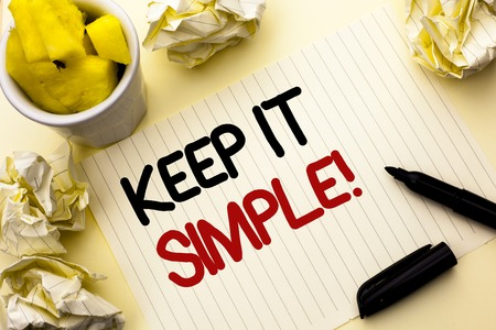 Photo pour Conceptual hand writing showing Keep It Simple Motivational Call. Business photo showcasing Simplify Things Easy Clear Concise Ideas written Notebook Paper the plain background Cup Marker - image libre de droit