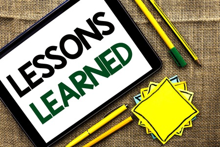 Text sign showing Lessons Learned. Conceptual photo Experiences that should be taken into account in the future written Tablet the jute background Pens Pencil and Sticky Note Papers