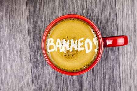 Conceptual hand writing showing Banned Motivational Call. Business photo text Ban on use of steroids, No excuse for building Muscles. written Coffee in Red Cup Grey wooden background. Top view.